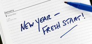 """new year - fresh start"" written on notepad"